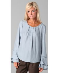 The Addison Story - Blue Tiered Ruffle Sleeve Blouse - Lyst