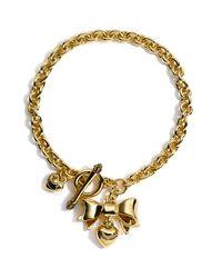 Juicy Couture | Metallic Wish - Bows Charm Bracelet | Lyst