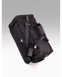 5e5a54b08895 Lyst - Prada Nylon leather Roll Duffle Bag in Black for Men