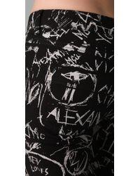 McQ - Black Graffiti Print Ankle Jeans - Lyst