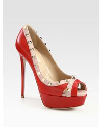 2e9e717a75b0 Lyst - Valentino Rockstud Leather Platform Peep Toe Pumps in Red
