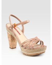 ce00be7685c0 Lyst - Prada Patent Leather and Cork Platform Sandals in Natural