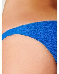 Free People - Blue Solid Smocked Mini Bottom - Lyst