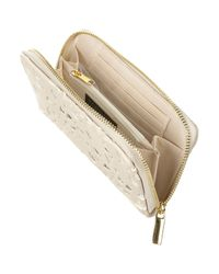 TOPSHOP - Natural Cream Cut Out Zip Around Purse - Lyst