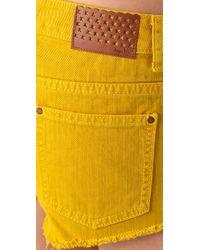 67cb03ddef Tigerlily Overdyed Carranza Denim Shorts in Yellow - Lyst
