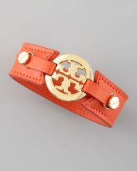 Tory Burch - Metallic Etched Leather Logo Cuff Orange - Lyst