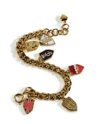 Juicy Couture - Metallic Gold Assembled Shield Charm Bracelet - Lyst