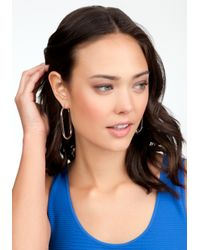 Bebe - Metallic Oval Hoop Earrings - Lyst
