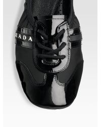 Prada - Black Lace-up Flats - Lyst