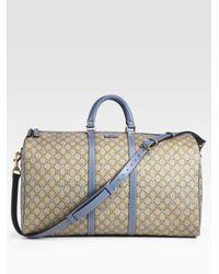 Lyst - Gucci Large Gg Pu Stars Fabric Carryon Duffel in Natural for Men f06fcf5dfe1f5