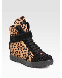 Miu Miu - Black Calf Hair and Studded Suede Wedge Sneakers - Lyst