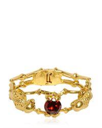 Alexander McQueen - Metallic Swarovski Double Skulls Brass Bracelet - Lyst