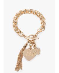 Bebe - Metallic Logo Heart Fringe Bracelet - Lyst
