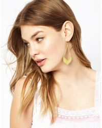 ASOS - Metallic Made Evil Brass Earrings - Lyst