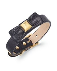 Juicy Couture - Metallic Gold Tone and Black Leather Adjustable Bow Buckle Bracelet - Lyst