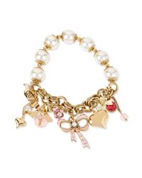 Betsey Johnson | Metallic Gold-Tone Girly Charm And Pearl Stretch Bracelet | Lyst