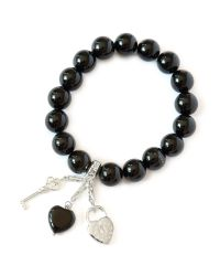 Charmology | Black Key To Safe Travel Onyx Charm Bracelet | Lyst