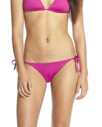 Becca | Purple 'color Code' Side Tie Bikini Bottoms | Lyst