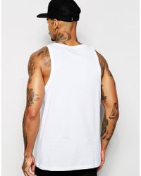 Men's White Longline Vest With Abstract Triangle Print In Relaxed Skater Fit