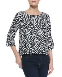 Dora Landa - Black Zebra-print Long-sleeve High-low Top - Lyst