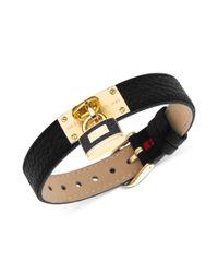 Tommy Hilfiger - Metallic Goldtone Lock Charm Black Leather Buckle Bracelet - Lyst