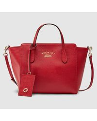 c1ac44345af0a5 Gucci Swing Leather Mini Bag in Red - Lyst