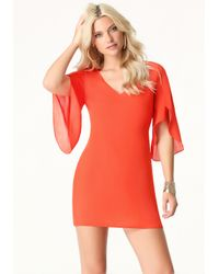 Bebe - Orange Draped Sleeve Shift Dress - Lyst