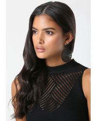 Bebe | Black Filigree Circle Earrings | Lyst