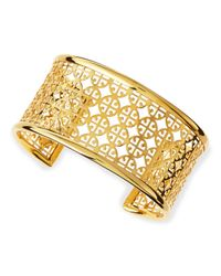 Tory Burch | Metallic Golden Perforated Logo Skinny Cuff | Lyst