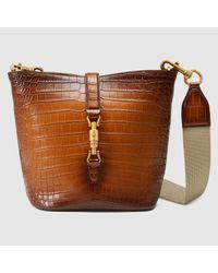 5963c3e6535 Lyst - Gucci Jackie Soft Crocodile Bucket Bag in Brown