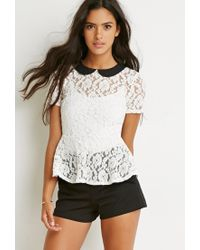 6ca3cb93b47192 Lyst - Forever 21 Floral Lace Peplum Top in White