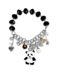 Betsey Johnson | Metallic Silvertone Panda Multicharm and Bead Stretch Bracelet | Lyst