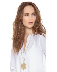 Tory Burch - Metallic Perforated Logo Pendant Necklace - Lyst