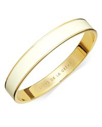 kate spade new york - Metallic 12K Gold-Plated Cream Enamel Creme De La Creme Idiom Bangle Bracelet - Lyst