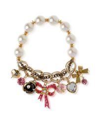 Betsey Johnson | Metallic Antique Goldtone Pink Bow Multicharm Half Stretch Bracelet | Lyst