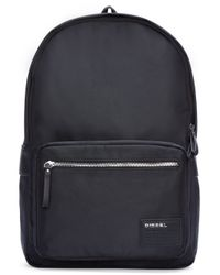 DIESEL - Black Coated Canvas Drum Roll Backpack for Men - Lyst