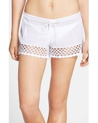Becca | White 'It Girl' Crochet Trim Crinkled Cotton Shorts | Lyst