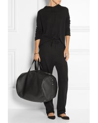 The Row - Black Textured-leather Weekend Bag - Lyst