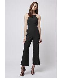 89474e2b9c5 Lyst - TOPSHOP Petite Wide Leg Jumpsuit in Black