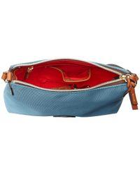"""Dooney & Bourke - Blue """"in"""" Nylon New Slgs Styles Crossbody Pouchette - Lyst"""