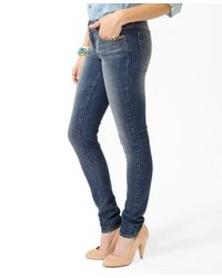 Forever 21 - Blue Studded Pocket Skinny Jeans - Lyst