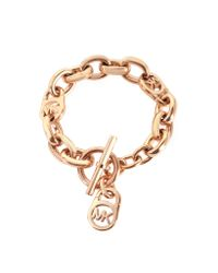 Michael Kors | Pink Heritage Rose Gold-tone Logo-lock Charm Women's Bracelet | Lyst