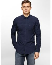 Calvin Klein | Blue Jeans Slim Fit Garment Dyed Poplin Utility Shirt for Men | Lyst