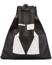 McQ - Black And White Leather Drawstring Backpack - Lyst