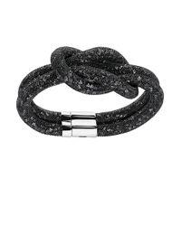 Swarovski | Black Stardust Knot Bracelet | Lyst