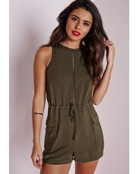 cae957dd19 Lyst - Missguided Sleeveless Ladder Detail Playsuit Khaki in Natural