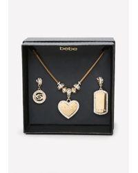 Bebe | Metallic Logo Charm Change Necklace | Lyst