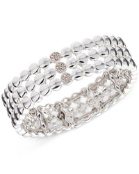 Nine West | Metallic Silver-tone Pavé Disc Three-row Stretch Bracelet | Lyst