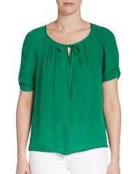b72ab7e7235c8 Lyst - Joie Berkeley Pleated Silk Blouse in Green