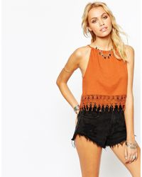 ASOS - Orange Festival Crop Top With Halter Neck And Crochet Trim - Lyst